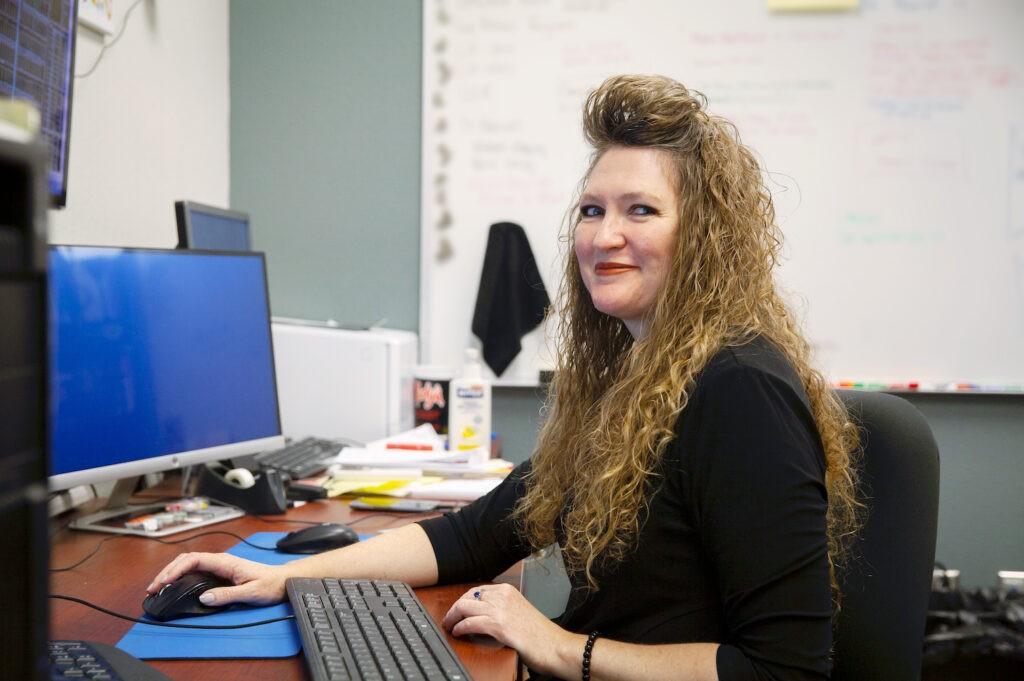 Saddler at her SCADA computer workstation
